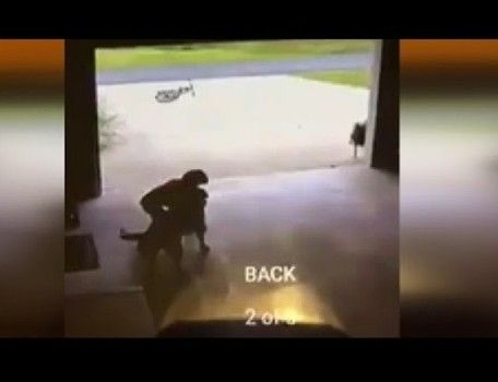 Boy sneaks into neighbor's garage to give their dog a hug in viral video