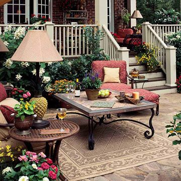 Love the wrought iron coffee table for the deck.