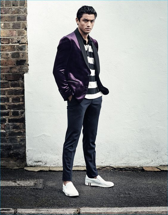 Luiz Piva models a purple velvet blazer and striped polo shirt from Bally for GQ France.: