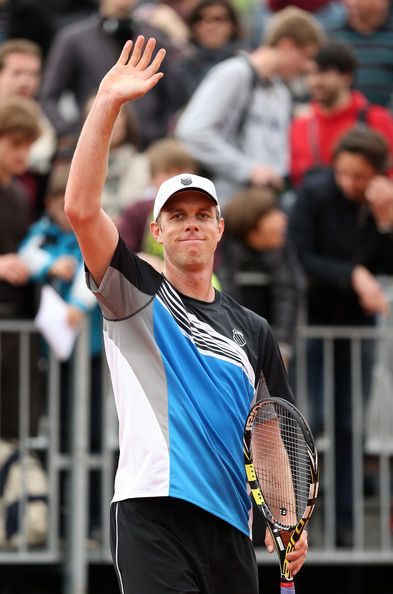Sam Querrey of thre United States celebrates match point after his men's singles match against Lukas Lacko of Slovakia during day one of the French Open at Roland Garros on May 26, 2013 in Paris, France.