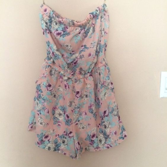 Pink floral romper Very cute floral romper. Light pink color. Removed tags but never worn. Bought from foreign exchange Foreign Exchange Dresses
