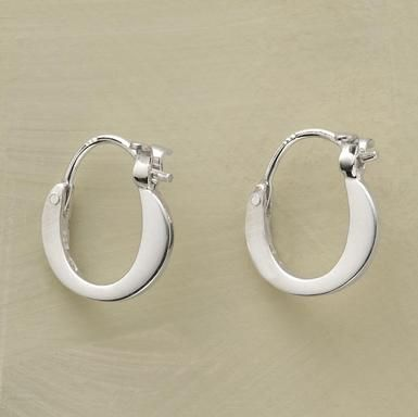 """Our self-locking hoops follow a graceful, roundabout route. Hand cast of sterling silver. 3/8"""" dia."""