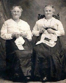 Twins doing handwork, c. 1900:
