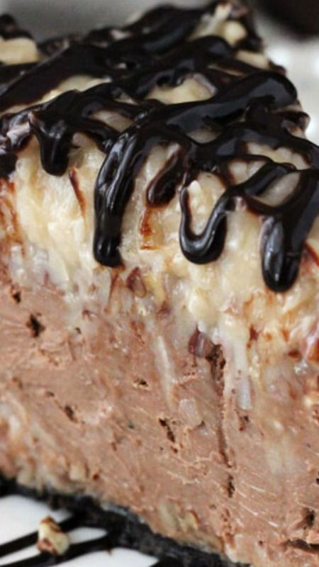 German Chocolate Cheesecake ~ Delicious! With a chocolate crust, chocolate cheesecake and coconut pecan topping... it's a gooey, wonderful treat!