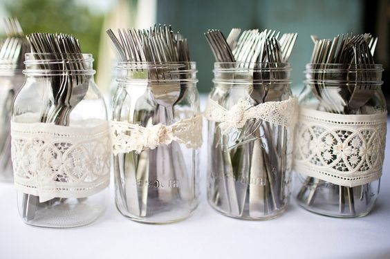 silverware in lace-wrapped masons. perfect with blue sheer ribbon instead of lace - work into centerpieces for each table?: