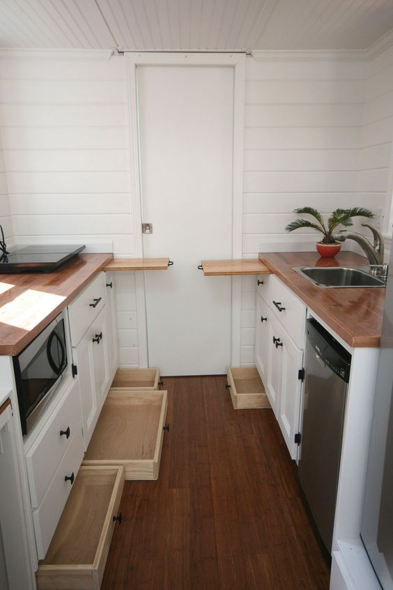 Drawers under all of the cabinets in a tiny home kitchen. Even more storage.:
