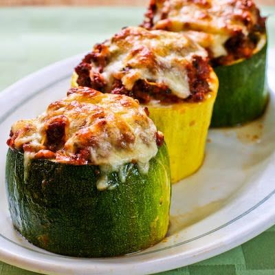 Meat, Tomato, and Mozzarella Stuffed Zucchini Cups  (Makes 6-8 servings)    Ingredients:  2 large zucchini or yellow squash, about 12 inches long  2 tsp. + 2 tsp. olive oil   1/2 cup finely chopped onion  1 green pepper, finely chopped  2 T finely minced fresh garlic  1 lb. ground beef  12 oz. ground turkey   2 C flavorful tomato-basil pasta sauce  2 cups low-fat mozzarella