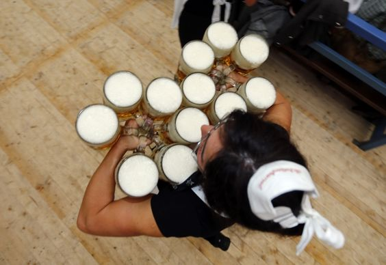 A waitress carries beer after the opening of the 179th Oktoberfest in Munich