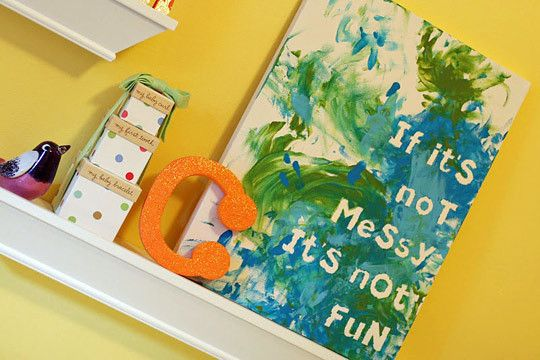 tape foam letters or letter stickers onto canvas before finger painting <3