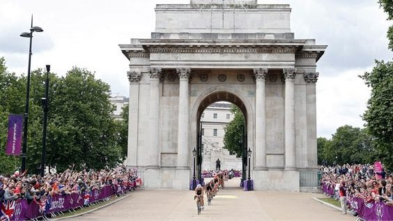 Athletes compete in the 43km cycling stage of the men's Triathlon during on Day 11 of the London 2012 Olympic Games at Hyde Park.   England
