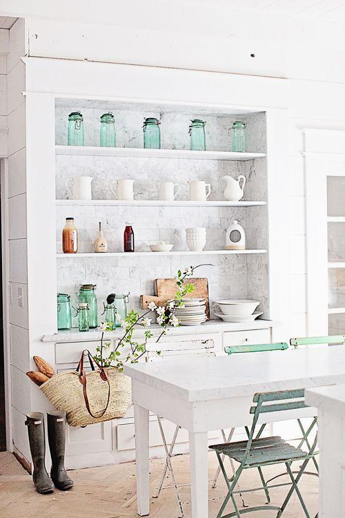 White kitchens design ideas: Farmhouse style white kitchen with white shelves and market basket. Dreamy Whites. #whitekitchen #farmhousekitchen #pastels #frenchfarmhouse #openshelves