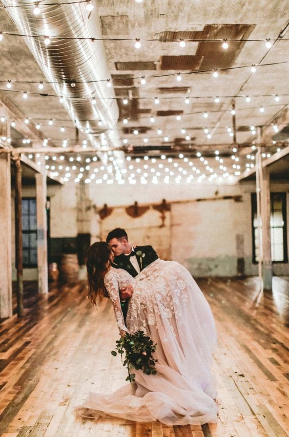 Industrial / contemporary wedding decor - stunning beige laced & floral wedding dress