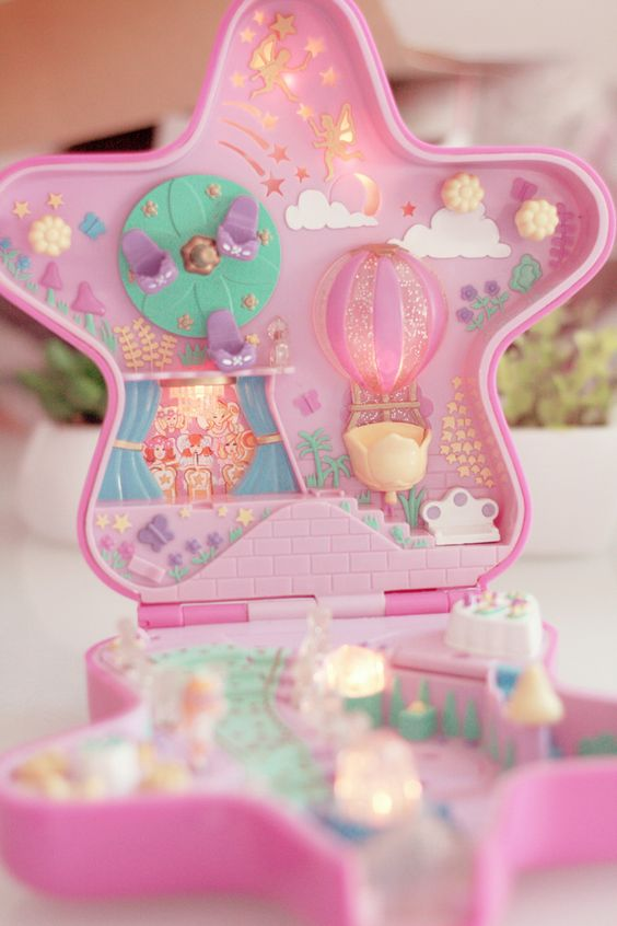 Remember these? Polly Pockets. Little lego-sized dolls with a pocketable house! I love it... Lauren and i totally had this one!