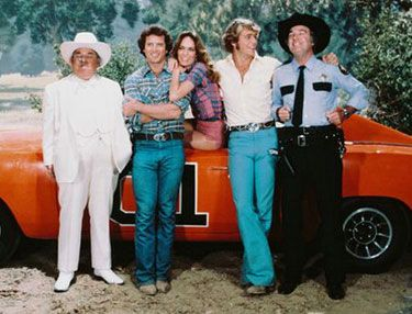 The Dukes of Hazzard was a TV series from 1979 to 1985. It was inspired by the 1975 film Moonrunners and had identical or similar character names and concepts. The Duke Family - cousins Bo (John Schneider) and Luke (Tom Wopat), assisted by their cousin Daisy ( Catherine Bach) and their uncle, Jesse (Denver Pyle) - fight the system and root out the corrupt practices of Hazzard County Commissioner Boss Hogg (Sorrell Booke) and his bumbling brother-in-law-Sheriff Rosco P. Coltrane (James Best).