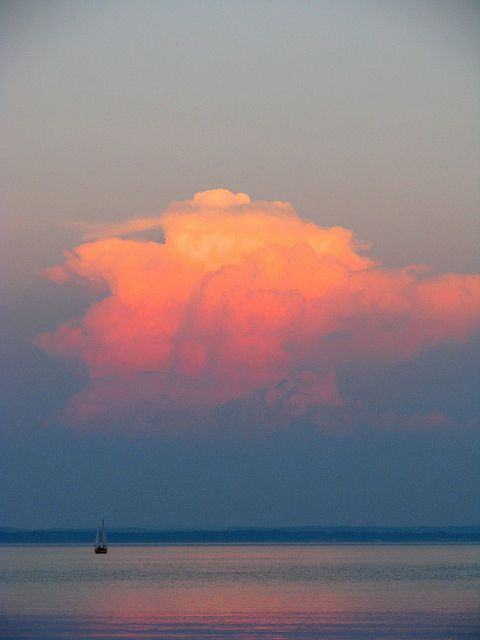 Sunset-lit cumulus clouds over Grand Traverse Bay