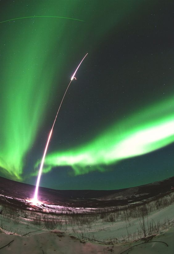 A rocket, aurora and satellite all in one photograph.