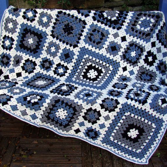 I am saving this for the idea of using different size granny squares in a blanket.  This of course, could be any color combo of 4 of your choosing.:
