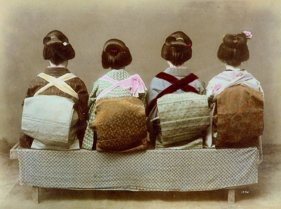 https://flic.kr/p/4yEdfu | SHOW ME the OBI !!! -- Geisha Turn their Backs on the Cameraman | Ca. 1880s-90s large-format albumen print. Here's a SALT PRINT made from the same negative, and hand-colored by another studio : www.flickr.com/photos/24443965@N08/2559706751/  Variations of this arrangement were taken by many photographers during the Meiji era. What are those crossed suspenders doing over the Obi's ? Are they wearing Bar-B-Q aprons on the other side ???  Nope. Flickr member MOEFN has...:
