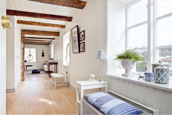 the contrast of the beams on the ceiling with the white are beautiful @Edie Wadsworth