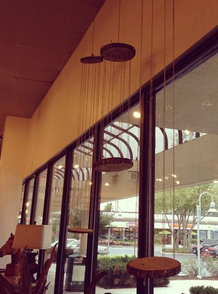 This window decor in Bliss caught my yesterday. Wooden discs hanging at different levels from rope.