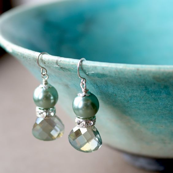 Very pretty crystal teardrops in electric green topped with a clear crystal rondelle and a sage green glass pearl The simple hook ear wires are