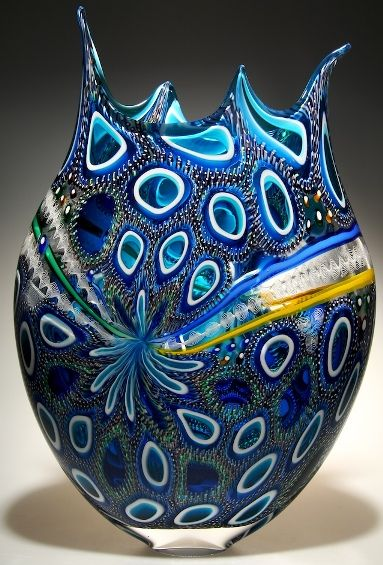 A blue murrine cane blown glass art with elegant designs