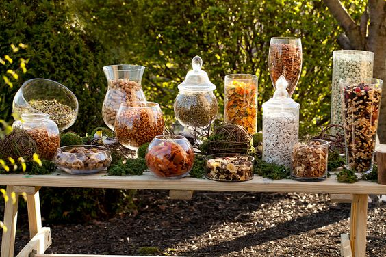 """""""Rustic"""" snacks for on the tables? I was thinking about doing apple/pear/fall harvest flavored candies but this might work well too. Things like trail mix and dried fruits..."""