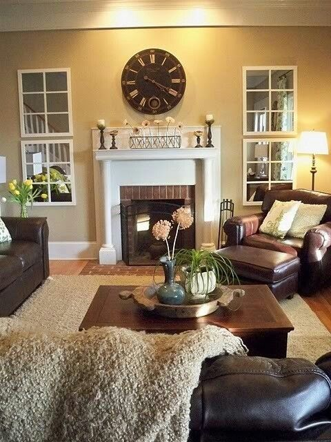 Love the mirrors around the fire place- nice idea to make a room feel bigger and paint he fireplace white