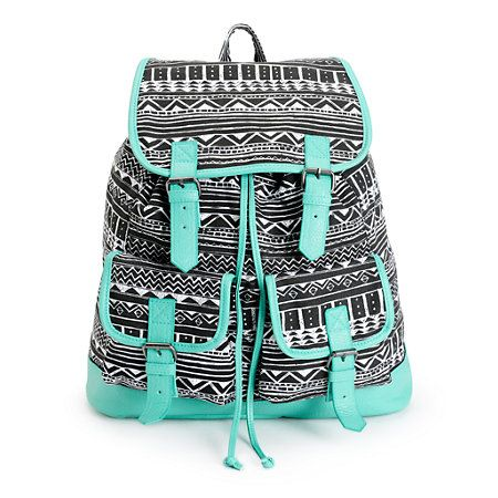 Carry all of your essentials with the style of the tribal print canvas exterior with contrasting Mint trims, while the pockets and compartment offer ample storage space.