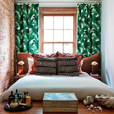 Even rich people have tiny bedrooms in Manhattan. Jungle leaf curtains