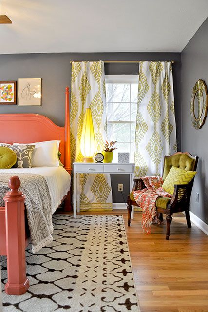 Love the mix of patterns, unexpected colors like melon and citron against the medium gray walls. Very inviting.: