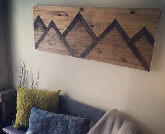 This Mountain Range wood wall art piece is 16.5 w x 48 l. It is perfect for hanging over a bed, mantel, or in a hallway. The photographed piece
