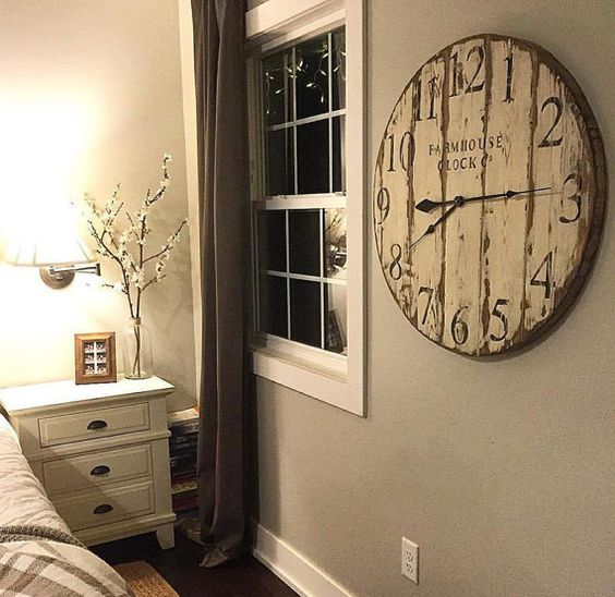 The Farmhouse Clock Co. Round wooden wall clock looks right at home in any country or vintage style decor. The Clock face measures 30 inches