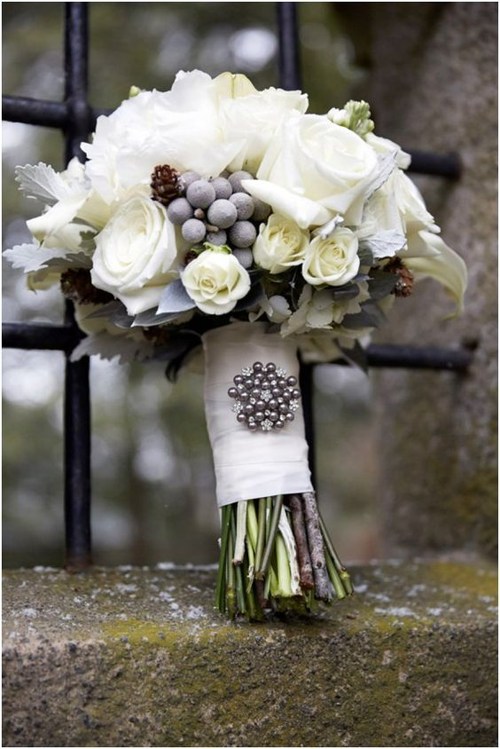 Love the use of flowers and berries for this winter wedding bouquet... accented by a pretty pin!  Bridal Bouquet by Matthew Douglas as seen on Hill City Bride: