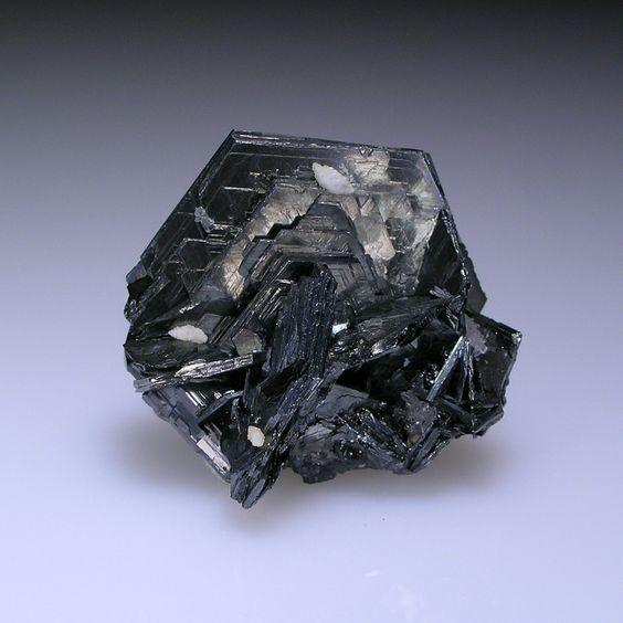 Polybasite, [Ag9CuS4] [(Ag,Cu)6(Sb,As)2S7], San Guillermo Vein, San Luis Shaft, Proano Mine, Mun. de Fresnillo, Zacatecas, Mexico. Dimensions: 2 x 2 x 1.4 cm. A sharp, lustrous, pseudo-hexagonal crystal, 2.0 cm across, with minor calcite, quartz and stephanite. Copyright: © Allan Young