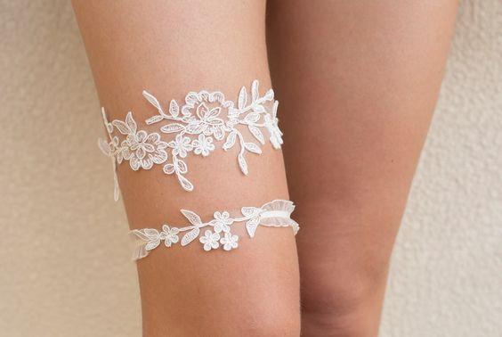 Bridal ivory lace garter set, floral bridal garter, wedding garter set by BeChicAccessories on Etsy https://www.etsy.com/listing/202576539/bridal-ivory-lace-garter-set-floral
