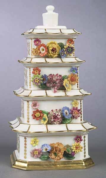 Paris Porcelain Pagoda-Form Scent Bottle, c. 1825, Jacob Petit, blue stopper above four etages, each decorated with applied flowers and bordered with gilt.