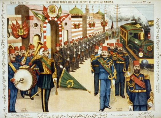 H.H. Hadji Abbas Helmi II. Kedive of Egypt at Madina surrounded by a band, group of men with rifles and railroad train. Lithograph, color print created approximately in 1910.  Credit:  Library of Congress Prints and Photographs Division Washington, D.C. 20540 USA .