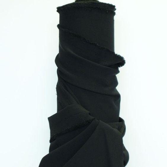 Black 4 Way Stretch  97% Polyester 3% Elastane  An Italian ex-designer, light medium-weight 4 way stretch, woven fabric in black.