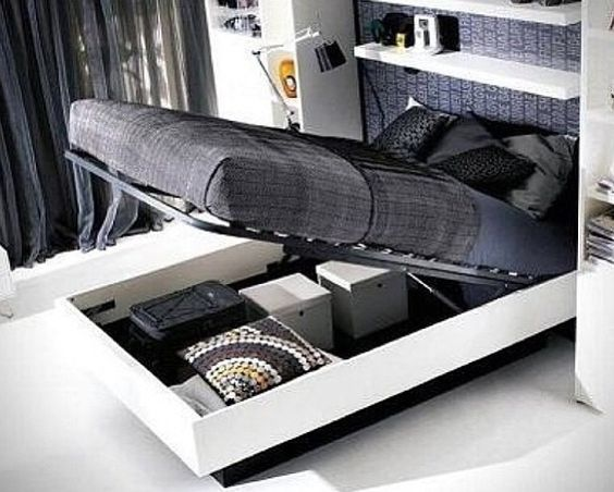 Bed lifts up for storage.... This is awesome!