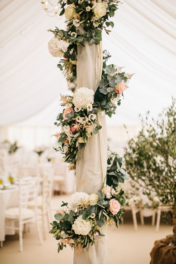 Marquee Poles With Floral Decor