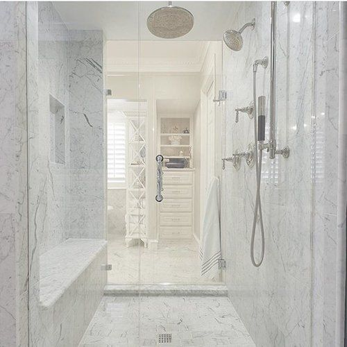 A His And Hers Bathroom Connected By A Pass Through Marble