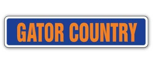 "GATOR COUNTRY -Street Sign- gators fan signs lover gift by ZANYSIGNS. $8.99. Great for Indoors or Outdoors. Proudly Manufactured in the U.S.A.. Brand New, Top Quality Sign. Makes a Great Gift!. Sign Size: 4""x 18"". This sign is 4""x18"" and made with an exterior grade PVC plastic and printed with the best inks in the industry. Perfect for outdoor use for over 5 years or will look great inside. No rusting or fading indoors or out. The sign come with round corners and 2 holes f..."