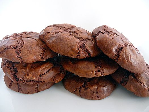 Better-than-Brownies Chocolate Cookies    Makes 24 large cookies    2 2/3 cups (about 16 ounces) bittersweet chocolate, chopped  4 tablespoons unsalted butter, at room temperature  4 eggs  1 1/3 cups granulated sugar  1 teaspoon vanilla extract  ½ cup all-purpose flour  ½ teaspoon baking powder  1 cup semisweet or bittersweet chocolate chips