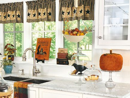 For festive fall decor that hangs in the balance, fill a fruit scale with miniature pumpkins and gourds and hang it above the sink. And, capture a country crow beneath a cloche or a cake dome to further enhance your kitchen's autumn flavor. Find more great decorating secrets in every issue of Country Sampler. Order your subscription here: https://ssl.drgnetwork.com/ecom/csl/app/live/subscriptions?org=csl&publ=CS&key_code=EYJCS02&source=pinterest