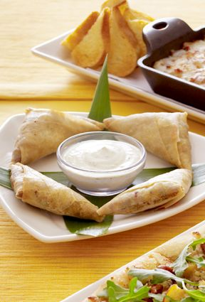 Cheesecake Factory Chicken Samosas - Cilantro-yogurt dip: 1½ tablespoons whole cumin seeds 1 cup fresh cilantro leaves 1 small fresh green Thai chile, sliced ¾ cup plain whole-milk yogurt 1 tablespoon fresh lemon juice 1 teaspoon sugar, plus more to taste Salt and freshly ground black pepper Samosas: 2 tablespoons grape seed, corn, or other neutral oil, plus more for deep-frying 1 cup diced onion 1 tablespoon peeled and minced fresh ginger 1 tablespoon minced garlic 2 tablespoons whole…
