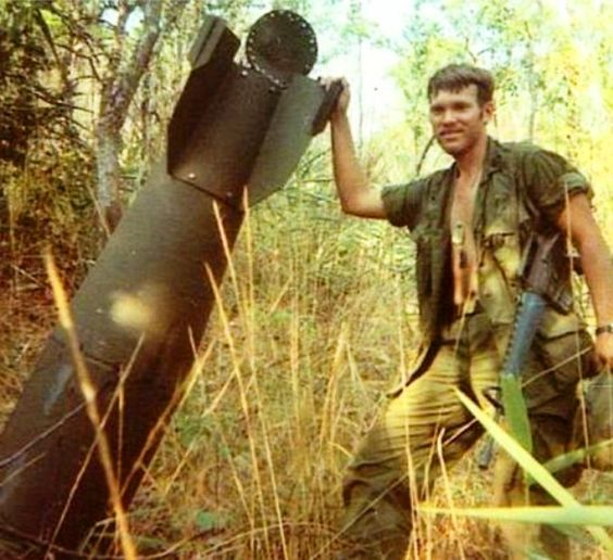 A US soldier finds a large, unexploded aeroplane bomb in the jungle during the Vietnam War.
