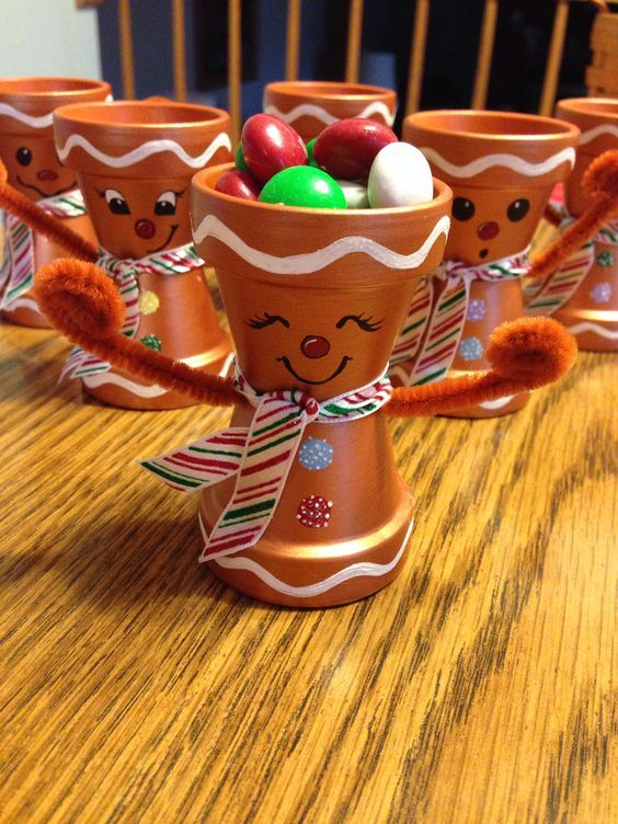 Clay pot gingerbread men! Quick and easy for a holiday craft :) paint pots green and make into a grinch for grinch night?: