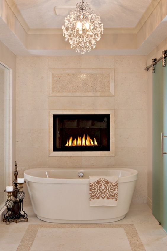 Bathroom: Fireplace above the tub