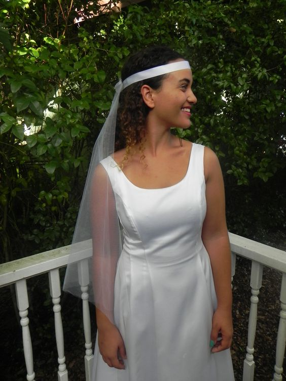 Do the 60's and 70's make you happy?  Get your old hippie on with a wedding headband/veil.
